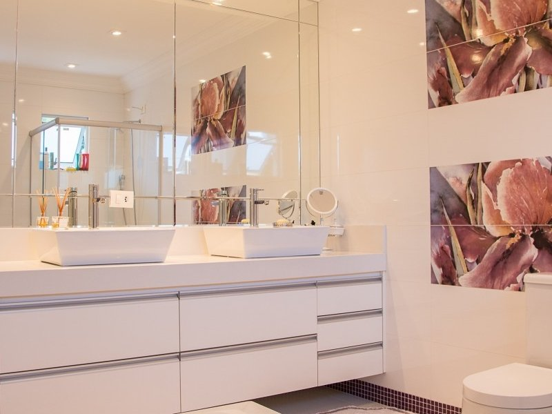 Bathroom reno ideas: use big mirrors and two sinks.