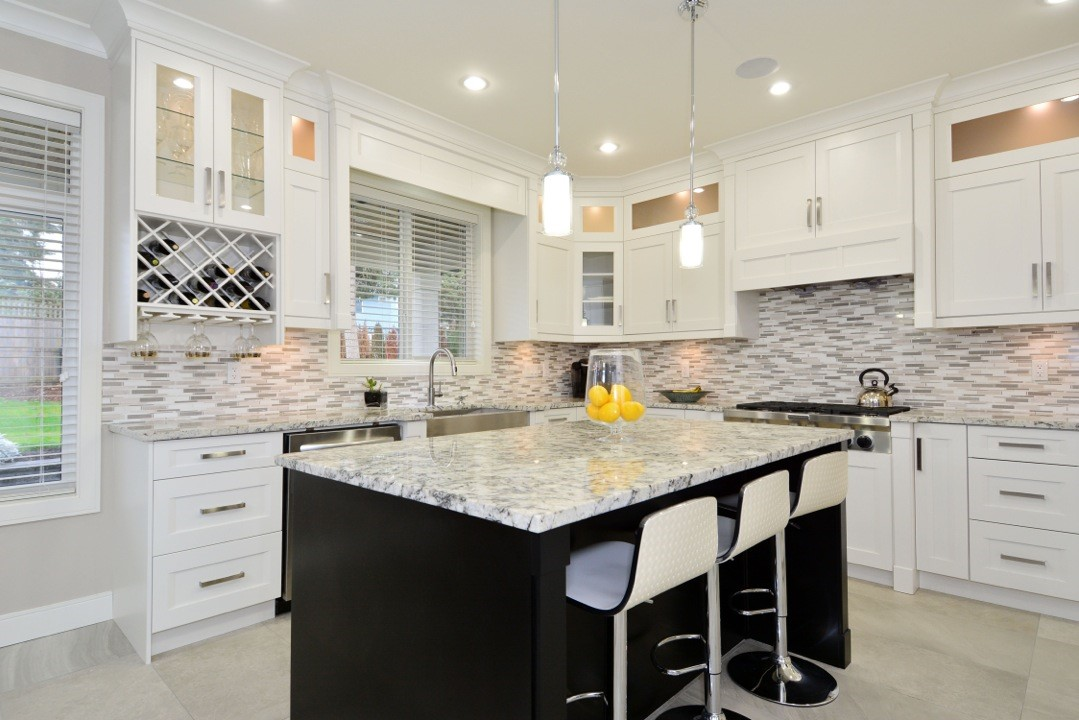 white kitchen renovation project with bar