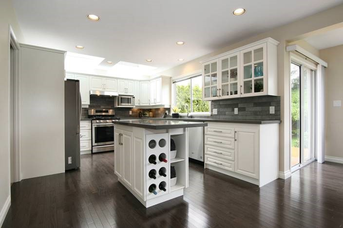 Kitchen cabinets renovation with flooring of a customers project: interior remodelling.
