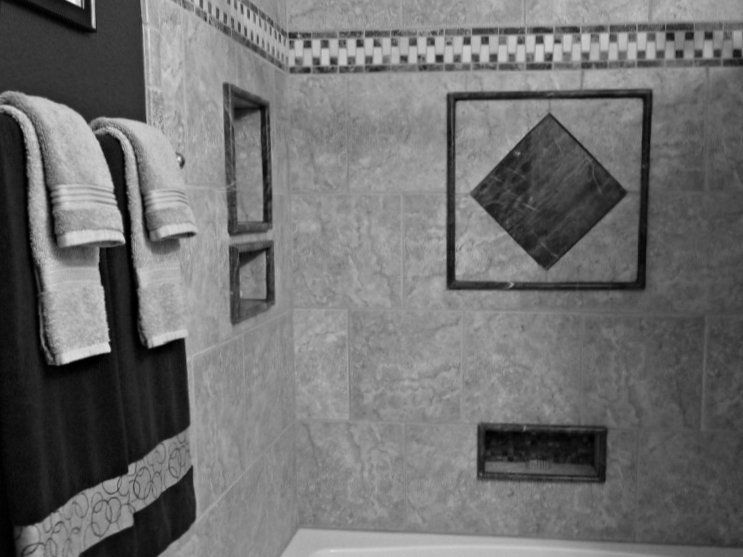 Bathroom tiles with an exotic finish.
