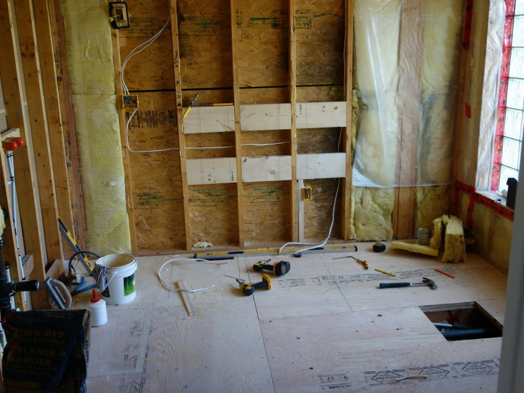 wood construction of the walls of a full kitchen renovation