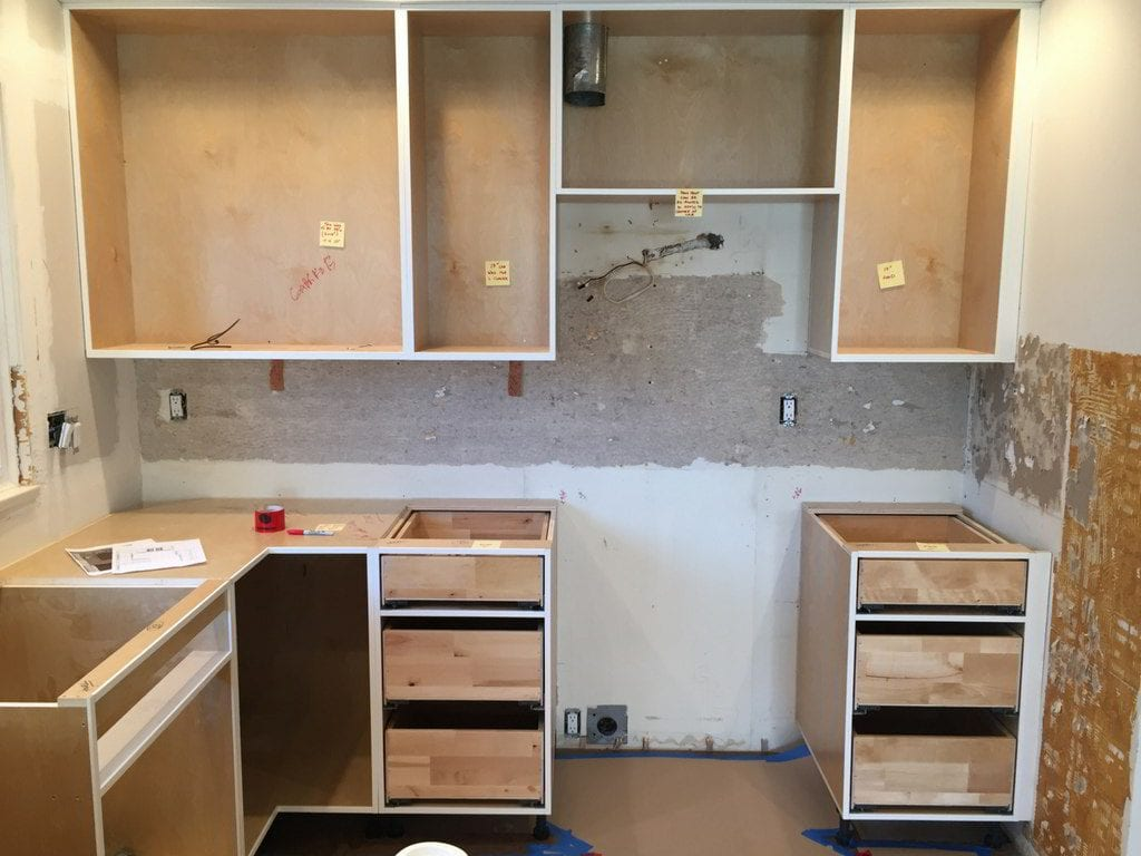 A kitchen prepaired for a kitchen cabinet refacing.