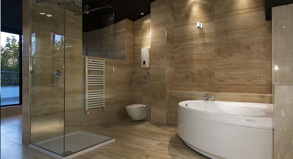 Bathromm in travertine marble after Bathroom Renovations, Surrey - MC Renovation and Painting
